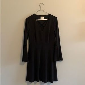 Black v neck dress with tapered sleeves